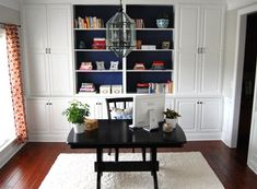 Dining Room built-ins. Add a big farmhouse dining table to work at on a daily basis but easily put away the work stuff for family gatherings.