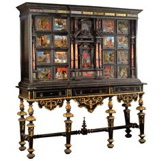 Cabinet on Stand featuring Psyche and Cupid (...) The stand dates within 50 years of the cabinet, features ebonized wood with parcel gilt swags, and, along with the cabinet, is consistent with similar pieces made in Naples during the last quarter of the seventeenth century. Naples and/or Belgium, 1690 | From a unique collection of antique and modern cabinets at https://www.1stdibs.com/furniture/storage-case-pieces/cabinets/