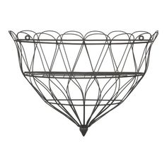 $9.95 Wire Wall Planter from Crate and Barrel. Just ordered 2 of these to use as wall mounted fruit and vegetable baskets!