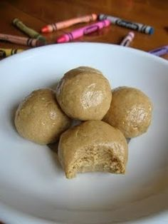 Peanut Butter Balls, your kids won't know they're eating a healthy snack and they will be begging you for more! They're easy to make, just mix together the ingredients and freeze for two hours.