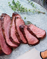 Seared Sous Vide-Style Tri-Tip  - teal a chef technique without the fancy equipment: This is Nick Kokonas' trick for cooking sous vide at home. The tri-tip roast cooks slowly and gently in a sealed bag submerged in barely hot water, resulting in luscious, juicy beef. It's then grilled until nicely charred and rested for 10 minutes before slicing and serving.Recipe on Food & Wine Cooking Artichokes, Sous Vide Cooking, How To Cook Artichoke, Steak, Food, Eten, Steaks, Hoods, Meals