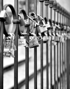 On a never-ending chain, It's a lock, a lock with both our names.  Lucchetti D'Amore - Love Locks  By: Howard Carson