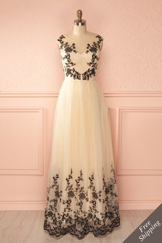 Elle se sentait come une princesse qui venait tout juste de trouver son prince charmant. She was feeling like a princess who just met her prince charming. Cream tulle maxi dress with black embroidery www.1861.ca