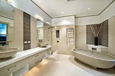 Modern bathroom design with twin basins using frameless glass Get Latest Designs & Decor Ideas for your Home at http://www.urbanhomez.com/decor Get hundreds of Designs for the Interiors of your Home at http://www.urbanhomez.com/photoshttp://www.urbanhomez.com/construction/wash_basin_and_toilet_seats http://www.urbanhomez.com/suppliers/architects/pune http://www.urbanhomez.com/suppliers/architects/chennai  http://www.urbanhomez.com/suppliers/interior_designer/pune