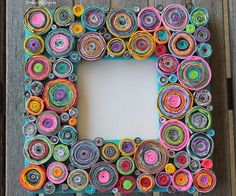 """Upcycled Rolled Paper Frame!This frame is visually stunning with lots of texture and pops of color!However...it's menace runs deeper.It was the most tedious and time consuming project I've ever wrangled my kids into doing.It all started like this. I had been planning this craft for a while...and my husband was out of town,so it seemed like a good time to catch up on projects.My nearly 12 year old son said """"hey mom, can I play Diablo?""""and I said """"Yes, but hel..."""