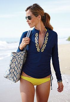 This ever-important piece of swimwear looks like a tunic, but protects your skin, and so stylish too!