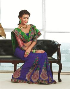 Introducing this designer saree as created especially for women's valuable occasions to give fabulous look to her beauty. This saree has a great combination of green (pallu) prism and royal blue skirt accompanied with embroidery on it, also the embroidery on the patli is accompanied by golden diamonds on it giving a fabulous shine to the saree and add an extra glamour to the look of every woman wearing the saree. *Blouse included (Unstiched).