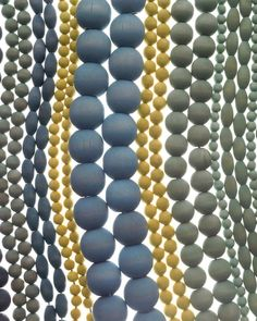 A quick dye gives unfinished beads a beachy, weathered look. These monochromatic necklaces, strung on leather cord, can be worn solo or piled on for effect.