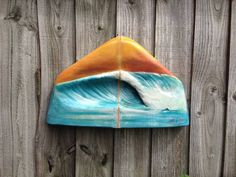 Surfing Sculpture by Melanie Rambo Weblink: http://www.notonthehighstreet.com/notajewellerybox/product/3d-wave-carved-surfboard-art-no-00008-purples-and-gold