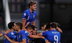 Daniele Rugani celebrates after Marco Benassi scored Italy's 2nd goal against England.