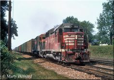 Its the early days of Burlington Northern although one would hardly know it with this consist as CB GP35 #2532 and GN GP35 #2518 (both already renumbered) hustle a long train of boxcars through Westmont, Illinois on August 29, 1970.