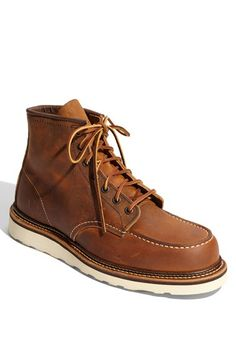 Free shipping and returns on Red Wing 'Classic Moc' Boot at Nordstrom.com. Rawhide laces secure a distressed pull-up leather boot with iconic moccasin-inspired design and contrasting rubber sole. A protective storm welt and comfy leather footbed insert enhance wear.