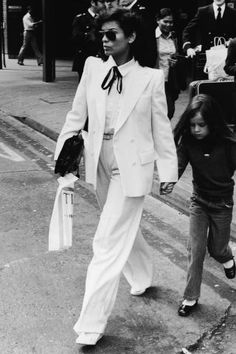 Bianca Jagger's iconic style broken down into 24 amazing looks.
