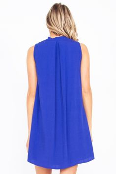 Quality made in the USA!!!  Blue  Button Down Shift Dress with Asymmetric Hem. Made from 100% rayon so it has a soft, silky look and feel. Plus rayon is breathable similar to cotton, only less expensive - Only -$40.00. Purchase securely via our eBay store at: www.stores.ebay.com/theofferbazaar. Also available at our web-store at: www.shopdirectonline.net.