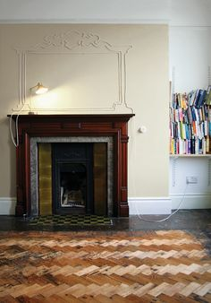 British artist Maisie Broadhead elevates the nuisance of an unsightly lamp cord to over-the-mantel art with this clever bit of DIY design. | Read more: http://www.dwell.com/articles/striking-a-cord.html