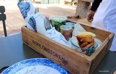 Lunch being served in wooden trays at the Greenhouse Restaurant - Babylonstoren.