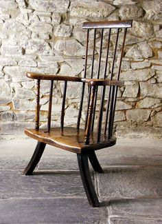 Welsh stick chair in ash from Montgomeryshire circa 1760 It has delicate turned spindles and large sweeping arms ending in wide hand-rests Antique Stick Chair Spindle Chair