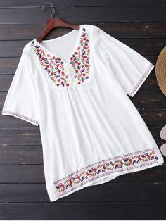 Floral Embroidered Tunic Blouse - WHITE ONE SIZE Material: Cotton Blends Clothing Length: Long Sleeves Length: 1/2 Collar: V-Collar Pattern Type: Others Decoration: Embroidery Style: Casual Weight: 0.3200kg Package: 1 x Blouse Occasions: Casual