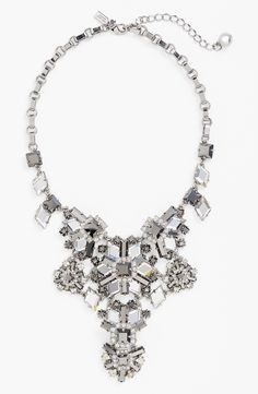 Will dress up a basic tee with this icy Kate Spade statement necklace.