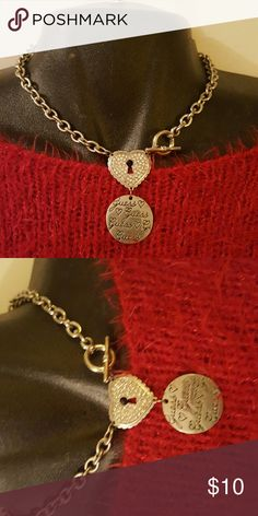 Guess Toggle necklace Silver necklace toggle clasp , heart with rhinestones n circle stating Guess.. Guess Accessories