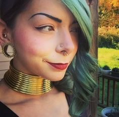 We are loving all your beautiful Karen Coil pics! Here is from Kyklops Tattoo in Pittsburgh rocking hers. (We sold out of this shipment, but get your pre-orders in for the next one! Septum Nose Rings, Face Piercings, Piercings For Girls, Neck Rings, Posture Collar, Unusual Jewelry, Stretched Ears, Body Modifications, Photos Of Women