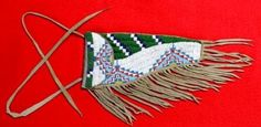"""This beautiful authentic piece is a wonderful survivor. Beaded Pistol Holster, 1890-1930's, Sioux, Northern Plains, ----, W-4 1/2"""", L-8 3/4"""", Brain Tanned."""