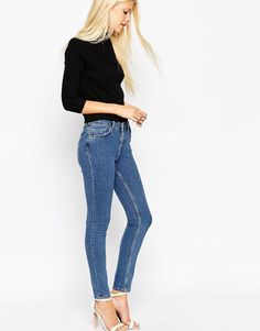 """Lisbon skinny jeans by ASOS Collection Mid-weight power stretch denim Classic five pocket styling Streamlined fit to the leg opening Mid rise Super skinny - cut closest to the body Machine wash 98% Cotton, 2% Elastane Our model wears a UK 8/W26"""" L32"""" and is 178 cm/5'10"""" tall"""