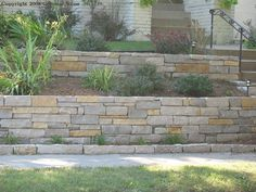 Terraced stone retaining wall...admire the variety in stone size and color!