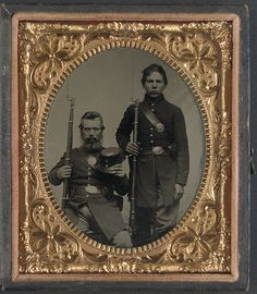 Two unidentified soldiers, possibly father and son, in Union uniforms and U.S. belt buckles with bayoneted muskets (LOC)