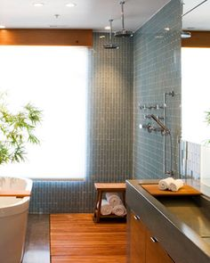 wood look tile on both the bathroom floor & in the shower