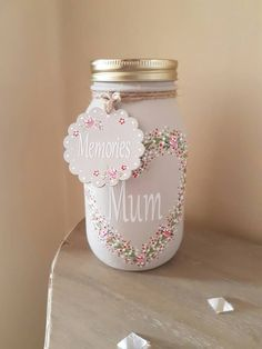Gorgeous hand made to order Mason jar - 17.5cm. This jar looks beautiful filled with flowers or used as a memory jar. It has a removable decorated lid and a hanging tag which says With Love on one side and Memories on the other. This jar is handpainted using chalk paint and