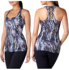 Practice your poses in style when you sport the STUDIO by Capezio® Women's Tatyana Printed Tank Top. This fitted tank features a built-in bra for shape, support and coverage in and out of the studio. The back lace detail is ultra-feminine, while the front shaped princess seams flatter your figure. The racerback design promotes mobility so you can complete your favorite activity with ease. Upgrade your gear with the Tatyana Print Tank Top.