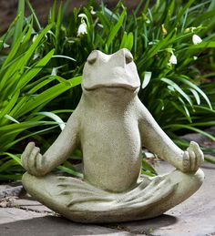 With froggy legs crossed, this Cast Stone Zen Frog Garden Statue sits in a meditative state in any indoor or outdoor setting. Made in the USA from solid concrete with an English moss-colored finish, this peaceful amphibian's eyes are softly closed and his froggy fingers are curled upwards, inspired by the Gyan Mudra hand position.  #zen  #frog #gardenart