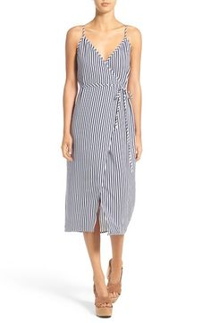 Free shipping and returns on Wayf Wrap Midi Dress at Nordstrom.com. Vertical stripes have a slimming effect on a breezy wrap-front midi dress with slender ties at the waist and a breezy split hem.