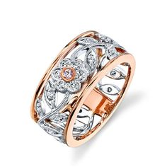 Simon G Vintage Style Flower Ring in 18K White and Rose Gold With 0.29 Carats White Diamonds and 0.04 Carats Fancy Pink Diamondhttp://www.bengarelick.com/collections/simon-g/products/simon-g-vintage-style-flower-ring-in-18k-white-and-rose-gold-with-0-29-carats-white-diamonds-and-0-04-carats-fancy-pink-diamond$1,650.00