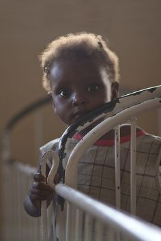 Child in orphanage in Haiti....photo by Andy Kennelly