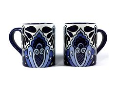 This set of two ceramic mugs is hand-painted in the style of traditional Mexican Talavera. They will make a gorgeous, brightly-colored addition to