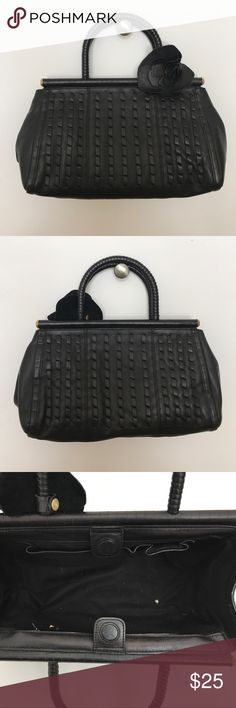 """Black Kenneth Cole leather handbag Black Kenneth Cole leather handbag. Used but in very good condition. Exterior looks brand new, interior could use a little cleaning. There are no tears or scuffs. Approximately 12"""" wide, 9"""" tall, and 5"""" deep. Reasonable offers will be considered! Kenneth Cole Bags"""