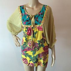 Ivy Jane BoHo blouse This flowing blouse is a super lightweight poly/rayon blend. Back hem falls 3in longer and underarm of sleeve has a loose fit. shoulder to front hem is 27in and sleeve is 3/4 length. ivy jane Tops Tunics