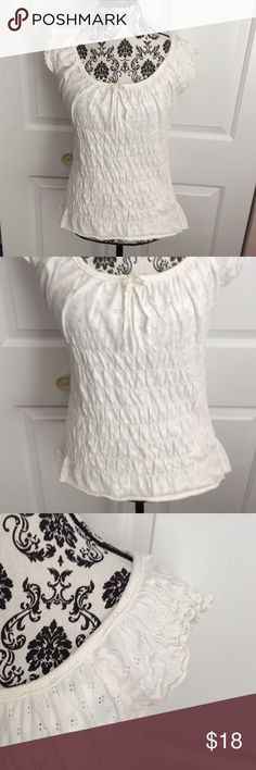 """{DKNY Jeans} Off White Ruffle Blouse Excellent used condition, no noted flaws! Color is an ivory/off white. Says """"DKNY JEANS"""" on the back at the top! Dress it up or down. From my pet and smoke free home. 100% cotton. No trades, please! DKNY Tops Blouses"""