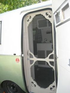 Definitely going to have one of these screen doors instead of those ugly RV ones!!! Pernod boler screen door.