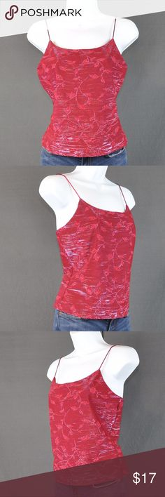 "Charlotte Russe Red Metallic Leaf Tank Sz: M All eyes will be on you when you enter the room wearing this tank. A deep garnet red combined with silver shimmer make this tank as hot as the weather. Pair with jeans or shorts.   46% acetate 26% polyester 20% metallic 8% Lycra  R/N: 95193 Style: Q870C390 Cut: 07452  Small pull/hole on front of top seen in 6th photo.   Measured laying flat:  Bust: 15"" Length: 19 3/4"" Hem: 15""  ❤️bundles ❌trades Please check out the rest of my closet, tons of…"
