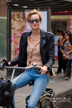 Style and the City - Leather jacket, peach shirt, jeans and a bycicle. That's all you need.