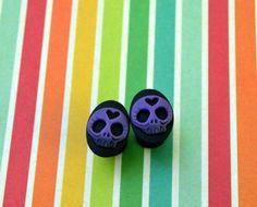 @Cindy Vega, these reminded me of you    Plugs - Sugar Skulls - Size 0 - Gauged Plugs. $13.00, via Etsy.