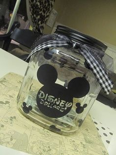 Vinyl + glass jar = super fun way to save for vacation :) i want to go to disney sooooo bad!!