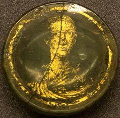Roman gold glass portrait of a young man, 4th century A.D. 4.5 cm diameter…