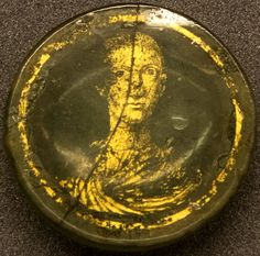 Roman gold glass portrait of a young man, 4th century A.D. 4.5 cm diameter…