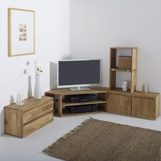 Edgar solid oak TV/Hi-Fi unit. This corner unit is part of the Edgar lounge range and is perfect to create a complete home entertainment centre. Made in Europe. Features of Edgar solid oak TV unit:Solid joined oak with an oiled finishInner shelf forming 2 compartments.Open back to allow cables to pass through.See other items from the Edgar collection online at laredoute.co.uk.Size of Edgar corner TV unit:Overall size:Width: 114 cm.Height: 35 cmDepth: 39.6 cm.Inside:Large compartment: L74...