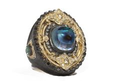 Old World midnight oval ring with cushion cut Blue Mother of Pearl/Rose of France with black and white diamonds and white sapphires and peacock pear tourmaline on the side.