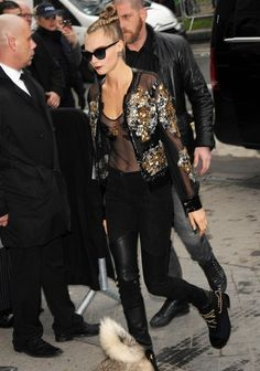 Only Cara Delevingne could make a sheer sequined bomber jacket look this effortlessly cool.